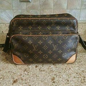 Authentic Louis Vuitton Nile Crossbody bag